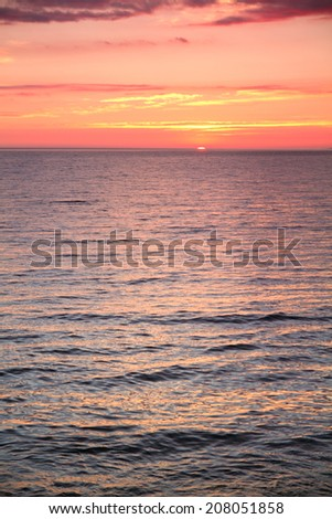 sunset at sea. variety of colors and hues of the rising sun