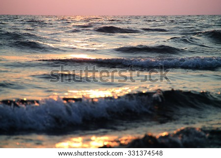 Sunset at sea waves - stock photo
