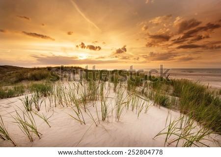 Sunset at Slowinski National Park in Poland - stock photo