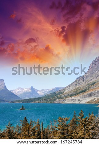 Sunset at St. Mary Lake from Wild goose island viewpoint, Glacier National Park, Montana. - stock photo