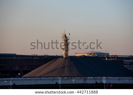 Sunset at steel factory showing coal bunkers - stock photo