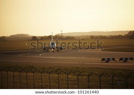 Sunset at the airport, Prague, Czech Republic - selective focus - stock photo