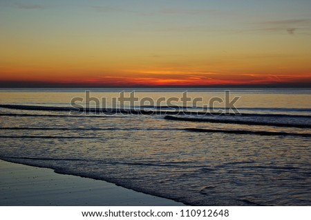 Sunset at the beach in The Netherlands. - stock photo