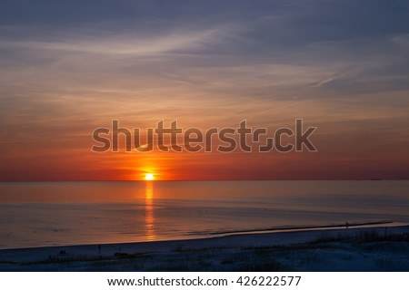 Sunset at the beach in Ventspils, Baltic Sea. Ventspils a city in the Courland region of Latvia. Latvia is one of the Baltic countries