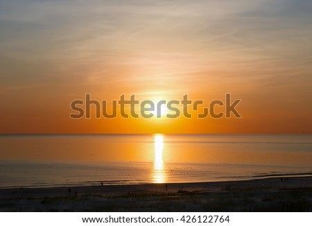 Sunset at the beach of Baltic Sea in Ventspils. Ventspils a city in the Courland region of Latvia. Latvia is one of the Baltic countries - stock photo