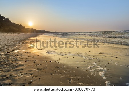 sunset at the beach of the  baltic sea in detail - stock photo
