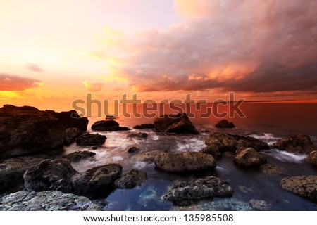Sunset at the Cove portland dorset in england - stock photo