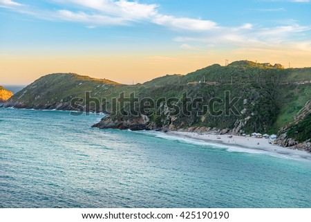 Sunset at the  crystalline and turquoise beaches of Pontal do Atalaia, Arraial do Cabo, Rio de Janeiro, Brazil.