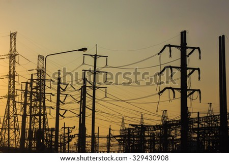 sunset at the electricity plant - stock photo