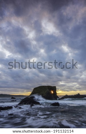 Sunset at the famous Elephant Rock in Ballintoy Bay, Northern Ireland. - stock photo