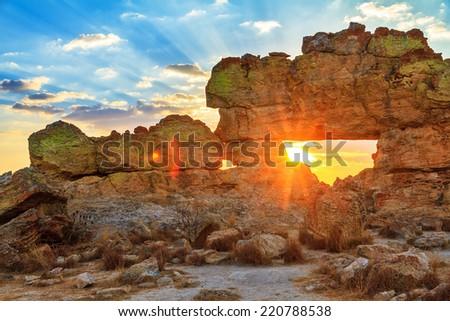 Sunset at the famous rock formation 'La Fenetre' near Isalo, Madagascar. - stock photo