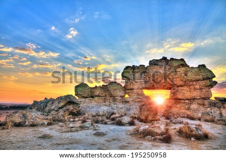 Sunset at the famous rock formation 'La Fenetre' near Isalo, Madagascar. HDR - stock photo
