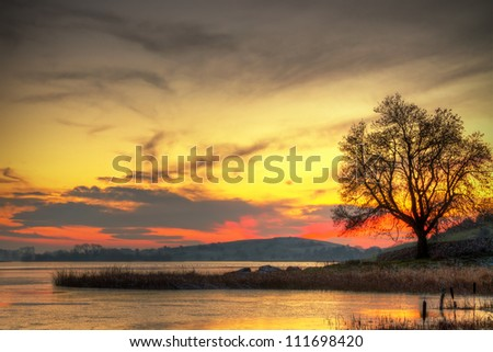Sunset at the lake in Ireland - stock photo