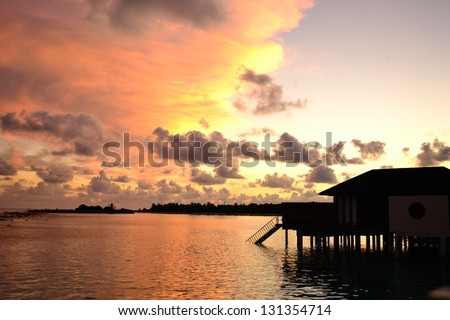 Sunset at the Maldives - stock photo