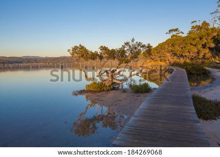 Sunset at the Merimbula Lake Boardwalk, Victoria, Australia. - stock photo