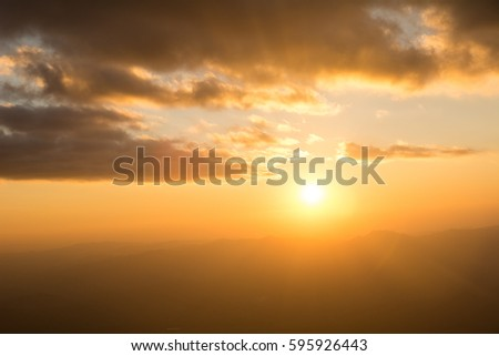 Sunset at the Mountain Hill,Beautiful sunlight, Golden lights background