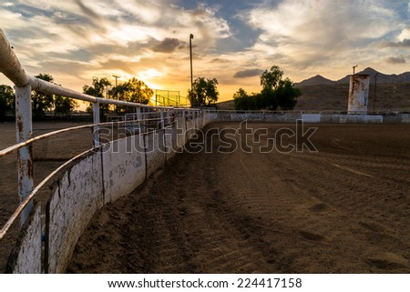 Sunset at the old rodeo grounds. - stock photo