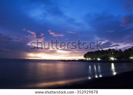 Sunset at the poor area of Malandog on Panay island in the Philippines - stock photo