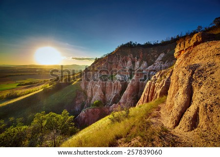 Sunset at the Red Ravine in Romania - stock photo
