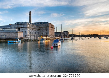 Sunset at the Royal William Yard docks in Plymouth on the Devon coast - stock photo