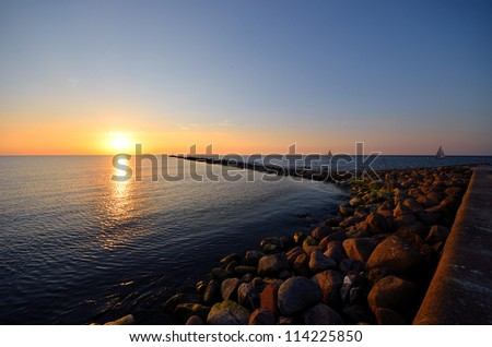 sunset at the sea shore - stock photo