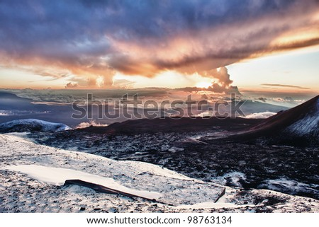 sunset at the summit of Mauna Kea in Hawaii - stock photo