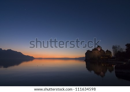sunset at the swiss lake with castle - stock photo
