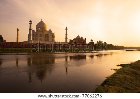Sunset at the Taj Mahal reflected in the Yamuna River - stock photo