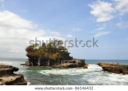 Sunset at The Tanah Lot Temple, the most important hindu temple of Bali, Indonesia. - stock photo
