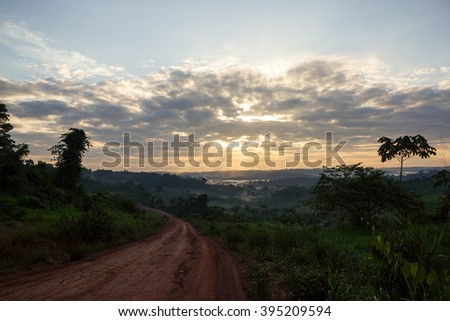 Sunset at Trans-Amazonian Highway in Brazil crossing the middle Amazon Rain Forest - stock photo