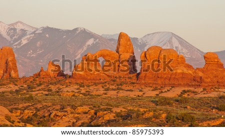 Sunset at Turret Arch with La-Sal Mountains. Arches National Park, Utah - stock photo