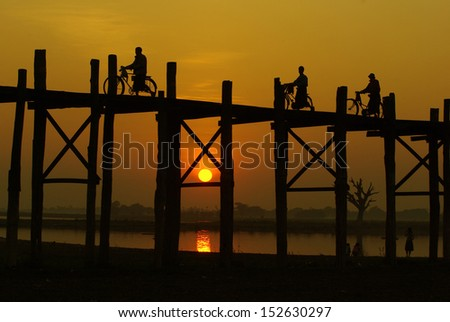 sunset at U-Ben Bridge with myanmar people, Amarapura, Mandalay, Myanmar