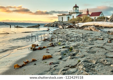 Sunset at West Point Lighthouse at Seattle Washington - stock photo