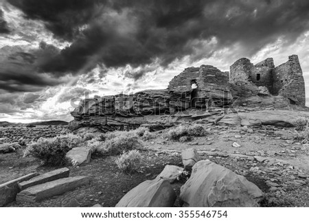 Sunset at Wukoki pueblo ruin in Wupatki National Monument near Flagstaff Arizona photographed in black and white. - stock photo