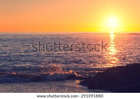Sunset beach with retro effect, Laguna Beach, California - stock photo