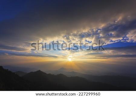 Sunset beam on top of mountain - stock photo