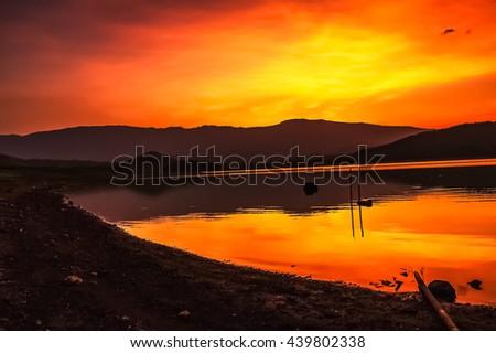Sunset. Beautiful sunset above black lake. Gold sunset. Blazing sunset. lake sunset. Amazing sunset Awesome sunset. Sunset & lake waves. Summer sunset. Landscape sunset. Beautiful sunset.phetchabun. - stock photo
