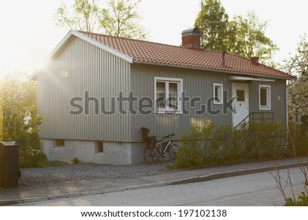 Sunset behind a house - stock photo