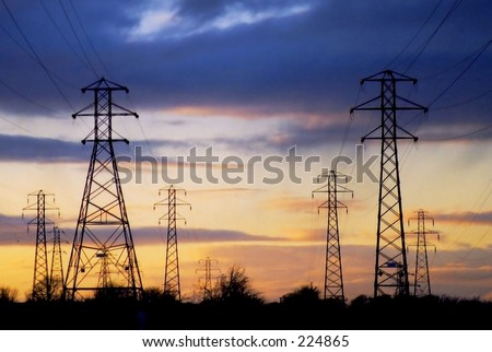 Sunset behind electricity pylons