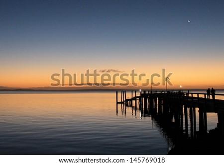 Sunset behind jetty on Fraser Island, Queensland, Australia. - stock photo