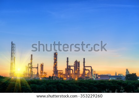 Sunset behind of the oil refinery plant. - stock photo