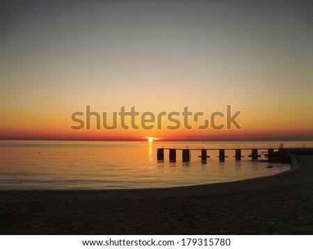 Sunset behind pier-Croatia - stock photo