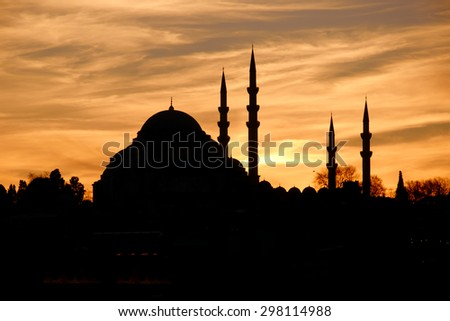 Sunset behind Suleymaniye Mosque in Istanbul Turkey - stock photo