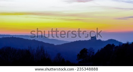 Sunset behind the Guegel hill church in the highlands of Franconia,Bavaria in Germany. Red Sunset