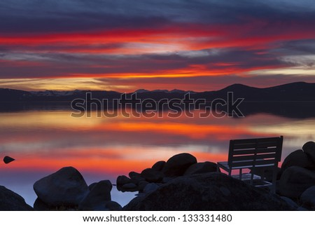 Sunset Bench at Sand Harbor with Empty Bench - stock photo
