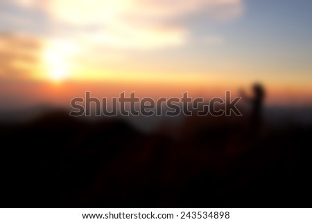 sunset blur evening with girl  on hill thailand abstract background - stock photo