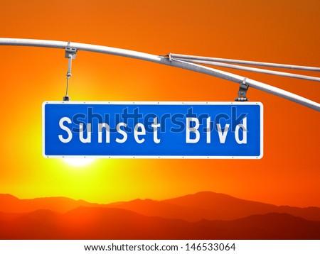 Sunset Blvd overhead street sign with orange dusk sky. - stock photo