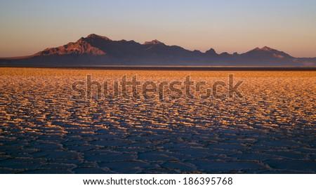 Sunset Bonneville Salt Flats Utah Silver Island Mountain Range - stock photo