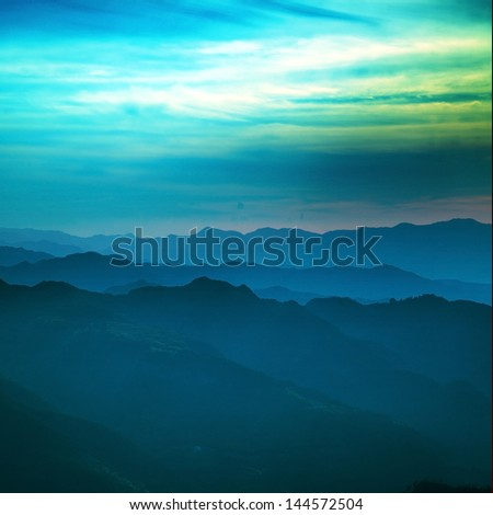 Sunset by the beautiful mountains (in Xianju County, Zhejiang Province, China) - stock photo