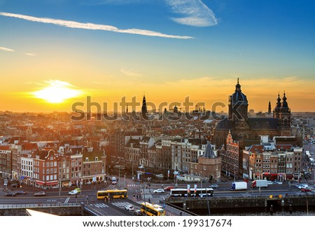 Sunset cityscape in winter of the skyline of Amsterdam, the Netherlands - stock photo